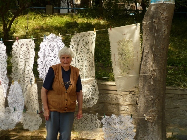 Woman in Old Town of Sozopol with Embroidery / Photo credit Jane Martin
