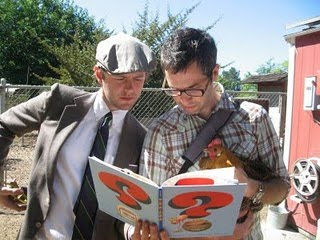Mac Barnett (left) and Adam Rex (right) read from their book _Guess Again!_ Photo via Barnett and Rex's blog Guys WIth Books