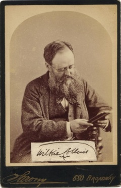 Wilkie Collins, 1874 via Wikicommons