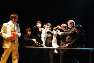The State Drama Theatre of Tbilisi performs a stage adaptation of <em>The Lady with the Pet Dog</em> (dir. Levan Tsuladze) in Israel. This production used puppeteers and marionettes to slant its actors' exchanges and perceptions, presenting two versions of reality, or points of view. Photo by Qali Sachuqrad.